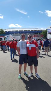 Photograph of Tosh Warwick and Duncan Stone outside a football stadium in Russia